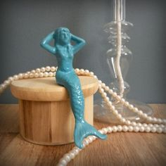 I have this lovely mermaid sitting on my desk. LOVE HER