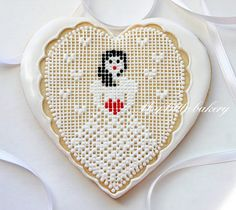 Valentine's Day cookie with cross-stitch technique..