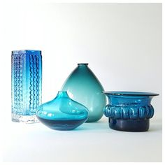 "Feeling blue....but good blue...happy blue!!! From left, 1960's brutalist art glass vase by Emil Funke for Gral-Glas Germany 7.5"" H $65.00, Small shapely posie vase unmarked 3.5"" H x 4.5"" W $18.00, ""le wide blob"" lovely aqua vase unmarked 6.5"" H x 5"" W x 3"" D $34.00 and lastly, Bertil Vallien for Boda Afors Sweden, one darn shapely MCM vase with great form and the original label on the  base, 3.5"" H x 5"" W $65.00. - - #thisisbeazley #midcentury #vintage #artglass #design #decorate #blueglass…"