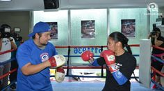 Former boxing champion Ana Julaton is hoping the addition of a wrestling coach will improve her ground game...