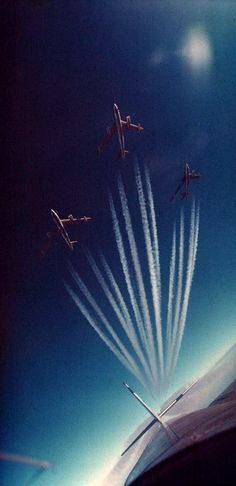 A contrail-making section of Boeing B-47 Stratojets streaks across the sky.