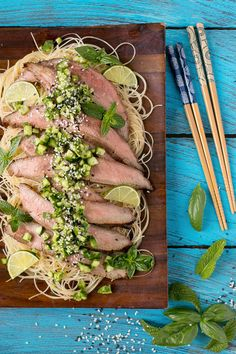 Soy marinated flank steak, grilled to perfection, topped with a refreshing cucumber relish and served on a bed of sesame noodles.