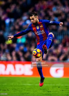 Jordi Alba of Barcelona controls the ball during the La Liga match between FC Barcelona and Real Madrid CF at Camp Nou stadium on December 03, 2016 in Barcelona, Spain.
