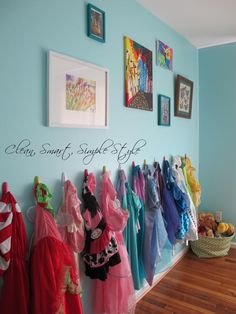 Dress up gallery wall. Blue girl's room.