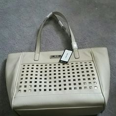 "NWT Nine West Large ""hidden agenda"" bag Large dark cream/light tan colored tote with a nest grid pattern on the front with underlay gold foil.  4"" D  12.5"" L 11"" H  8"" strap drop  Smoke and pet free home  Please feel free to ask questions, or request additional photos  Don't forget to bundle for discounts! Nine West Bags Totes"