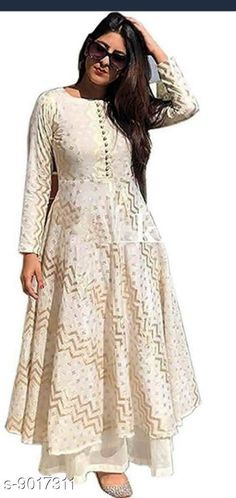 Checkout this latest Kurta Sets Product Name: *Women Rayon Flared Printed Long Kurti With Palazzos* Kurta Fabric: Rayon Bottomwear Fabric: Rayon Fabric: No Dupatta Sleeve Length: Long Sleeves Set Type: Kurta With Bottomwear Bottom Type: Palazzos Pattern: Printed Multipack: Single Sizes: S, M, L, XL, XXL Country of Origin: India Easy Returns Available In Case Of Any Issue   Catalog Rating: ★4 (3302)  Catalog Name: Women Rayon Flared Printed Long Kurti With Palazzos CatalogID_1557059 C74-SC1003 Code: 074-9017311-998