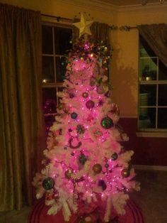 pink lights on white christmas tree