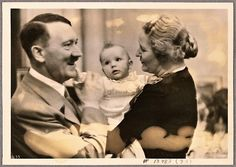 A nice spontaneous smile from Hitler in 1938 with Edda and Emmy Goering.