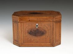 Harewood Twin Tea Caddy (c. 1790 United Kingdom) // Georgian Harewood Tea Caddy inlaid with boxwood & sycamore fluted cants, its edged and inlaid with a checquered boxwood & ebony stringing. This wonderful tea caddy is inlaid with superb Black Thorn Oysters, to the top, front, and both sides with the top being book matched. The back has a single burr yew medallion.   Contains most of its original tin lining. // Price  GBP 1850 //  - Maria Elena Garcia -  ► www.pinterest.com/megardel/ ◀︎