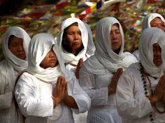 Women pray at Lumbini, Nepal / Lonely Planet Nepal travel guide. Photo © Chris Raven