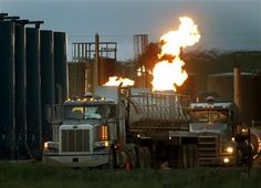 2016-7-18 - Fracking may worsen asthma for nearby residents, study says - Photo: drivers and their tanker trucks, capable of hauling water and hydraulic fracturing liquid, line up near a natural gas burn off flame and storage tanks in Williston, N.D. According to a 2005-12 study at Geisinger Clinic in Pennsylvania, fracking may worsen asthma in children and adults who live near natural gas drilling sites. People with asthma are vulnerable to air pollution...