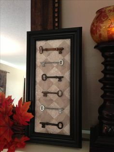 Old skeleton keys mounted on fabric in a shadow box frame. Like it?