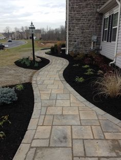 New landscaping and front paver walkway.
