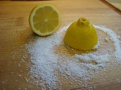 To clean a wooden chopping board, sprinkle on a handful of Kosher salt and rub with half a lemon. Rinse with clean water and dry to ensure it is clean and germ-free.