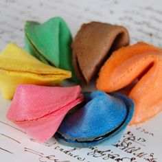 """beau-coup.com: """"Choose by color and flavor including blue, brown, green, natural, orange, lavender, pink, red and yellow.  Pick a color to match your party colors and choose by flavor: blueberry, chocolate, coconut, lemon, lime, orange, raspberry and original. (Chocolate flavored cookies are only available in brown.)  Personalize the paper fortunes with up to three lines of custom text. Cookies arrive individually wrapped in cellophane and stay fresh for up to three months."""" 60 cents each"""