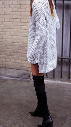 An oversized sweater and thigh high boots.