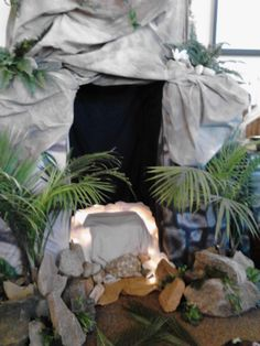 The Tomb was made from stacked cardboard boxes and we draped and tacked the cloth around to make it look like rock.  Put a light inside the tomb where Jesus would've laid.