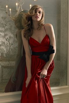 Deep Cherry colored gown with large black sash.