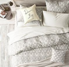 Soft linen-cotton bedding printed with an oversized ikat pattern in rich tonal shades creates a calm and comfy sanctuary.