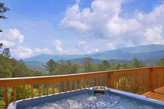 Halleluia - This 1 bedroom 3 bath cabin has a view that is breathtaking. Soak in the hot tub on the deck and view them to your hearts content! There are also rocking chairs to sit and relax. #americanmountainrentals #petfriendly