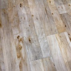 loving these over-bleached wood floors - reminds me of a beachy look!