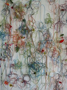 Manon Ferra, flower wall, 2009.  wire and string flower wall