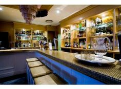 Housed in the trendy Grand Daddy Hotel, Daddy Cool is unashamedly over the top. Its golden bar has acres of white leather and treasures in jewellery b Glass Of Champagne, Jewellery Boxes, Cool Bars, Cape Town, Perfect Place, Night Life, South Africa, Daddy, Party Venues