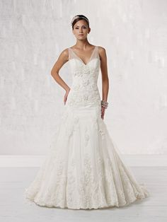 Sleeveless tulle and lace modified mermaid gown adorned with three-dimensional hand-crafted floral lace appliqués by Kathy Ireland
