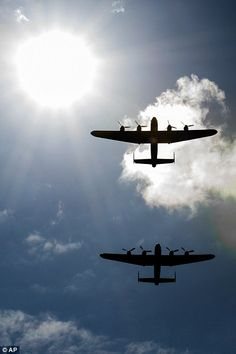 Dambusters reunited: Two WWII Lancaster bombers fly together over UK on Bomber Tour 2014. Vera (Hamilton, On) and Thumper.