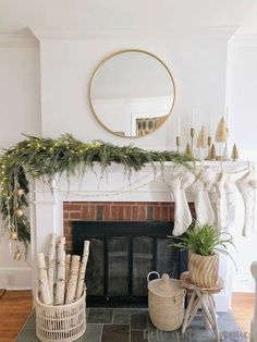 If you are looking to update your Christmas mantel decor, try using this asymmetrical Christmas garland idea to modernize your holiday decorating! #christmaslights #diy