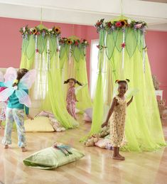 Just add strips of green tulle to a hula-hoop and decorate it with fake flowers.
