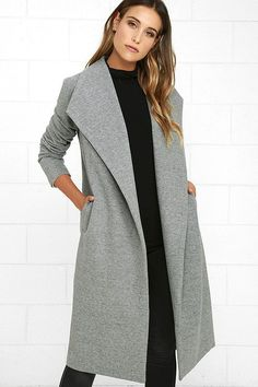 The Cozy Kind of Love Heather Grey Coat is the perfect addition to those chilly midnight strolls! Bundle up in soft, felted fabric that slopes from a pointed collar into a draping open front, framed by diagonal welted pockets and long sleeves. Darted bodice.