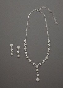 Delicate and graceful, this sweet Y-neck flower drop necklace and earring set is precious in every way.  Necklace and earrings showcase a beautifulfloral design.  Available in Silver.  Imported.