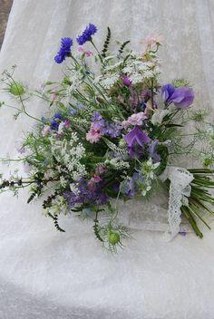 Image result for nigella and larkspur in flower arrangements