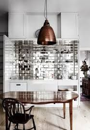 Loving the bevelled mirrored antique subway tiles