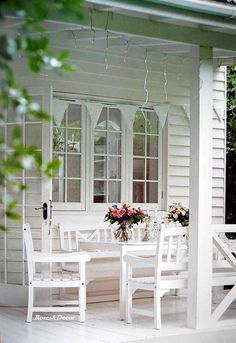 Beautiful white porch and roses