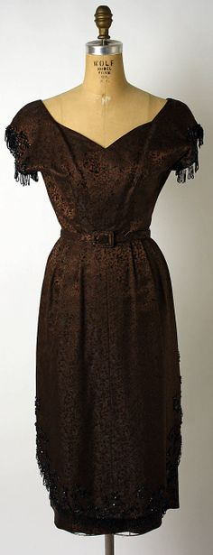 This cocktail dress was made in 1950 by Adele Simpson. She was known for pretty, feminine clothes in delicate prints and colors.