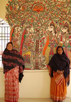 Artists in front of their mural in  Madhubani