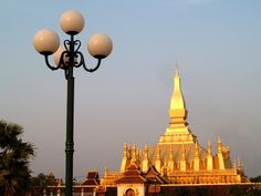 One of the most enjoyable views in Vientiane is the sunset over the Mekong River. You may also be able to watch a traditional dance. Vientiane, Countries Of The World, Asia Travel, Small Towns, Laos, Adventure Travel, Country, Temples
