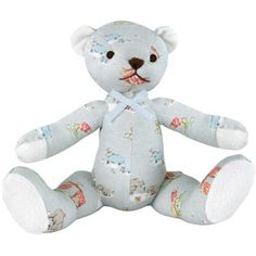 Lovable cloth teddy made with our cute Baby Zoo print, with friendly embroidered face and cotton towelling trim on ears and all four paws.  Also available in our Pink Rose Bed print.