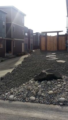 With rock landscaping and a rock pathway, the side of the townhouse is much easier to maintain.