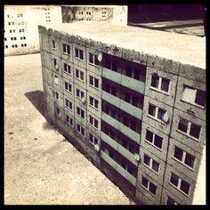 Blocks of flatted painted onto concrete blocks