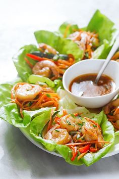 So tasty and easy to whip up for a quick lunch or a casual dinner! These shrimp lettuce wraps pack a flawless combination of flavors and textures: grilled shrimp with sautéed red peppers, carrots, … Shrimp Lettuce Wraps - healthy lettuce wrap recipes Shrimp Lettuce Wraps, Lettuce Wrap Recipes, Fish Recipes, Asian Recipes, Appetizer Recipes, Dinner Recipes, Healthy Recipes, Vegetarian Lettuce Wraps, Lettuce Wrap Ideas