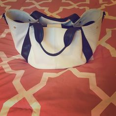 ✨Rylann✨JustFab Purse White faux leather body with black straps. Inside is deep blue, with 1 zipper pocket and 2 side pockets. Also includes an exterior zipper. Has buckles on sides to compact the purse (pic4) tried my best to get most of the discoloration out, but some remain due to use. Does not include shoulder strap. ❌no trades❌ JustFab Bags