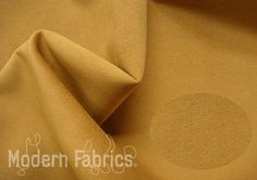 "Knoll Ultrasuede® K10214 : Aztec > Microfiber (Ultrasuede) > Modern Fabrics Store   Price: $38.00 per yard  Buy-The-Yard  Knoll Textiles  Pattern: Ultrasuede® Colorway: Aztec Content: 20% Polyurethane Binder, 80% Recycled Polyester Ultra Microfiber  Origin: Japan  Width: 55"" Weight: 17 oz per linear yard Durability: 200,000 double rubs"