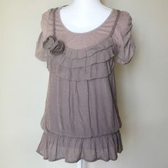 Adorable short sleeve ruffle top Layered look top with rushed sleeves and gathered waist. NWOT. Mine... Tops Blouses