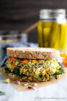 Tangy Vegan and Gluten Free Smashed Chickpea Salad Sandwich.  Made with dill and spicy mustard, this is an easy and quick make ahead sandwich or salad for healthy weekday lunches, dinners, or meals. You'll need canned chickpeas, dill pickles, red onions, just mayo or veganaise, stone ground mustard, apple cider vinegar, dill, turmeric.