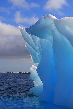 Luminescent Iceberg in Antarctica with sunlight.