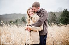 Engagement session in a hay field at Sterchi Hills Park in Knoxville Tennessee by Amanda May Photos