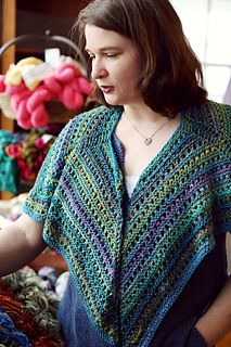 Starting at the neckline, this shawl is worked from the top down using raglan sleeve style increases to form its unusual shape. Thrown in some stripes and basic eyelet lace and you've got a show stopper that's surprisingly easy and quick to work up!